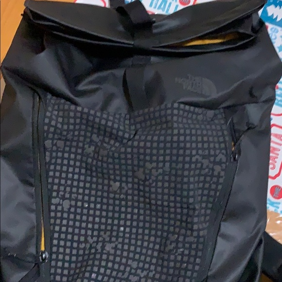 dc69dcfa9 A black The North Face Peckham backpack.